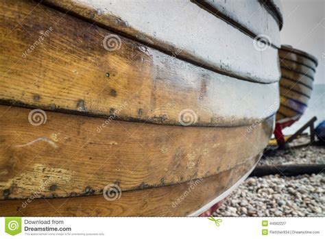 side of a fishing boat close up of the side of a wooden fishing boat stock photo