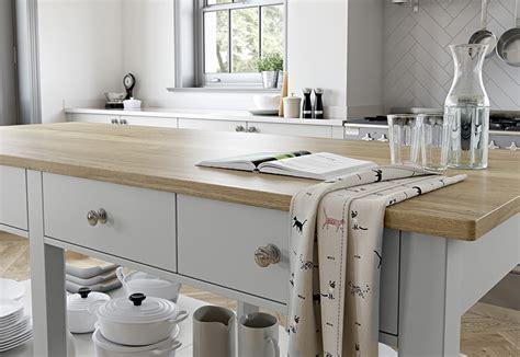 island unit take a tour around a sleek contemporary shaker kitchen doors georgia light grey dust grey uform
