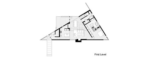 triangular floor plan triangular house with bridge to office loft overhead