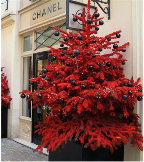 red flocked tree at chanel christmas yes please