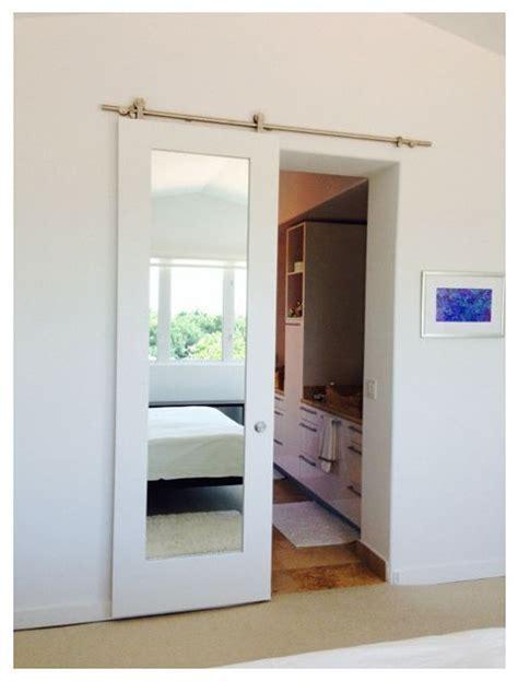 White Primed Mirror Doors On A Sliding Barn Door Track Barn Door Mirror