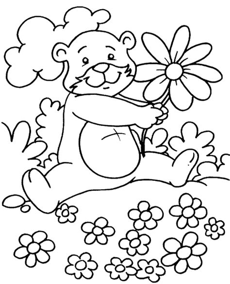 spring bear coloring pages bear on a meadow full of flowers to print or download for free