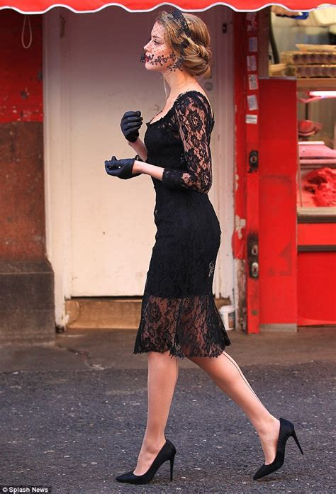 Best Seller Heels T Hak Black heard stands out in black lace dress and fascinator