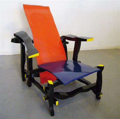 famous chair designs right handed designer reinterprets rietveld s most famous