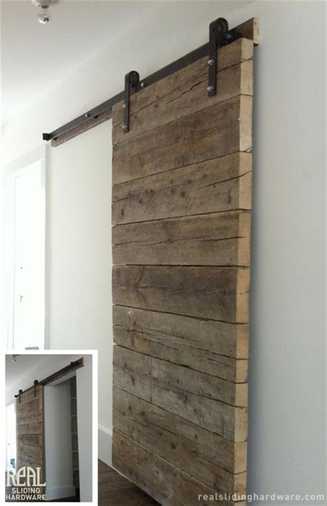 Reclaimed Barn Door Salvaged Plank Custom Barn Doors Rustic Living Room New York By Real Sliding Hardware