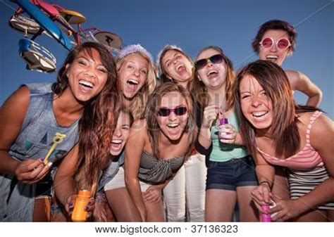 group teen girls laughing happy girls at carnival with bubbles image cg3p7136323c
