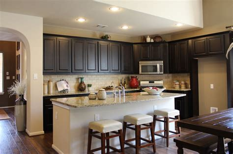 home design concepts kansas city brown kitchen cabinets with black captivating dark green