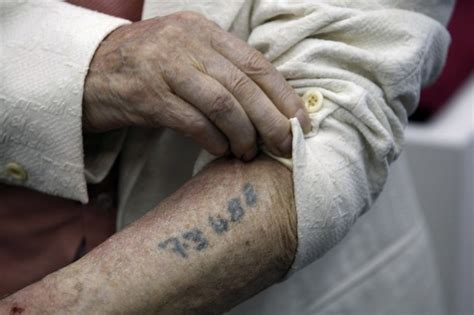 auschwitz tattoo european insurance companies continue to deny benefits to