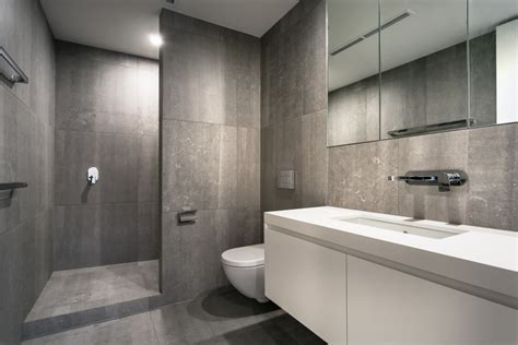 bathroom floor to ceiling tiles striking south yarra apartment renovation by canny