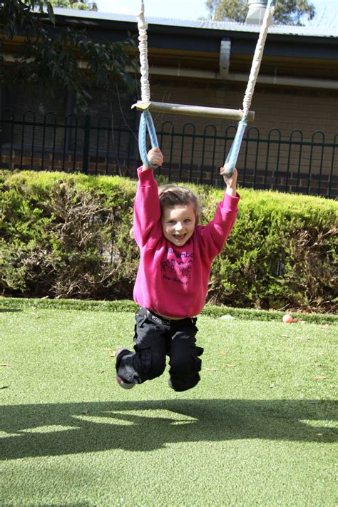 is swinging fun having fun on the swing set yarrambat preschool