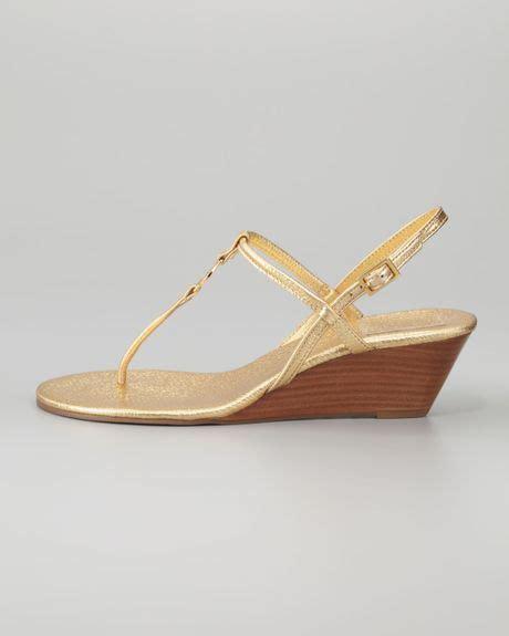 burch emmy sandals burch emmy metallic tstrap wedge sandal in gold lyst