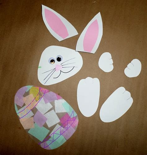 Easter Egg Paper Crafts - bunny holding an easter egg suncatcher crafty morning
