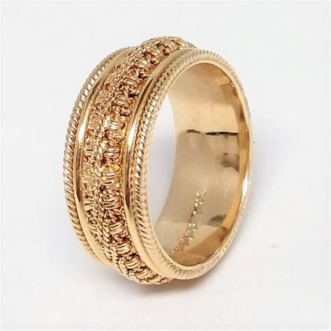 s yellow gold ornate chain and milgrain wedding band