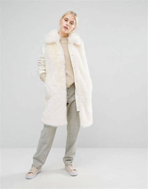 Careys Fur Coat Is Lost In The Mail by Carey Poses In Beside