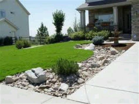 rock front yard landscaping along driveway anything outside