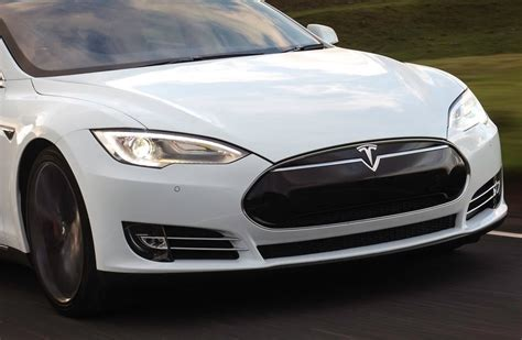 Is Tesla Motors Profitable Tesla Posts Quarterly Profit Second In History As