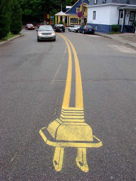 roadsworth adds  asphalt  surreal street art scenes