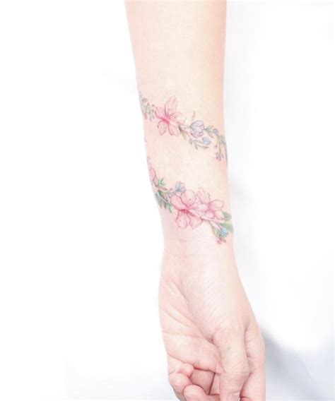 arm wrap tattoo designs the ultimate list of 50 awesome wrist tattoos for
