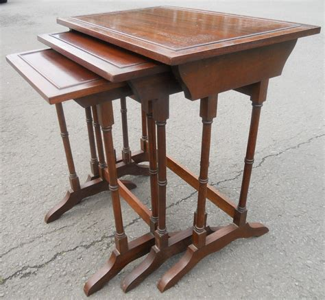 nest of three mahogany coffee tables in georgian style