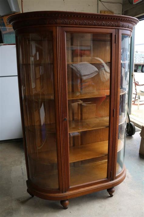 victorian oak antique curved glass curio cabinet with 4 shel