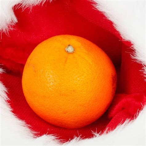 put oranges  christmas stockings