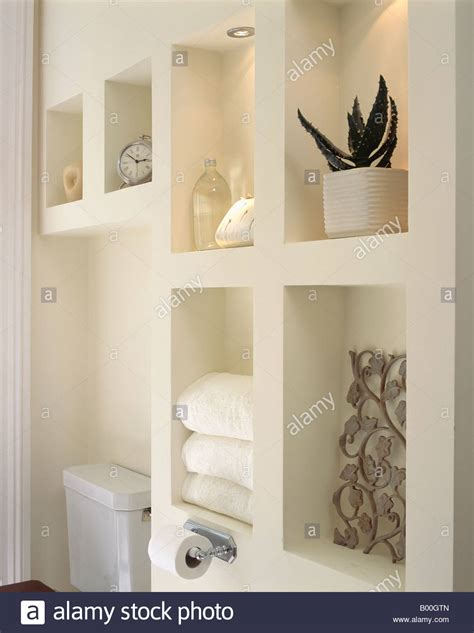bathroom alcove shelves close up of modern alcove shelving in white bathroom stock photo royalty free image