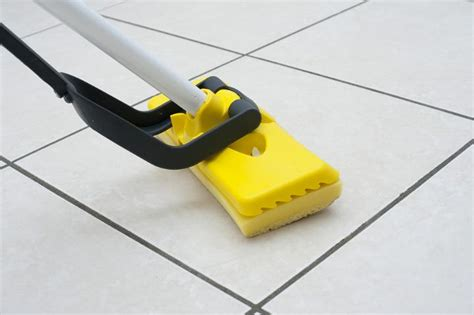 mopping bathroom floor image of mopping the floor using a plastic squeegee freebie photography