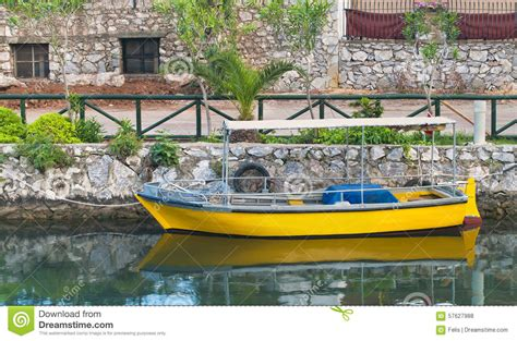 small yellow boat small yellow boat moored in canal stock photo image