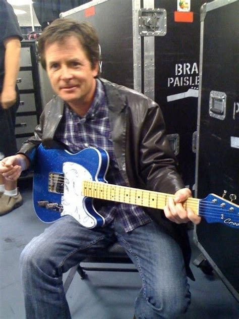 michael j fox ice skating michael j fox michael j fox playing guitar and ice skating