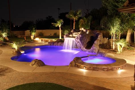 outdoor pool lighting stunning swimming pool and landscape waterfalls outdoor