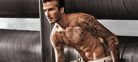 a guide to all of beckham s tattoos david beckham s coolest tattoos in pictures fashionbeans