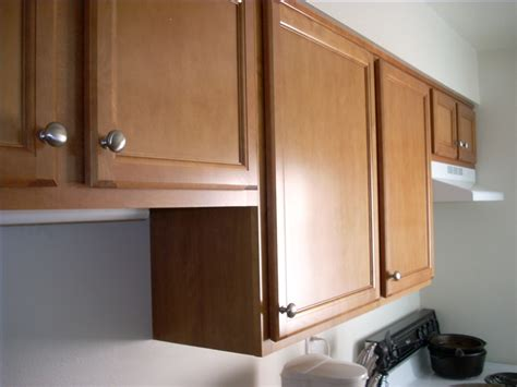 How To Install Ceiling Mounted Kitchen Cabinets Ehow How To Hang Cabinet Doors