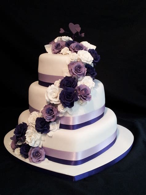 3 tier shaped wedding cake roses cascading with a purple theme purple themes