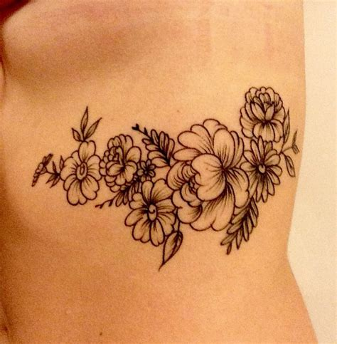 rib flower tattoo designs 17 best ideas about flower rib tattoos on