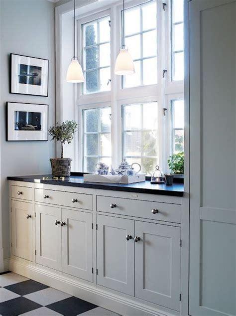 white kitchen black and white tiled floor soft gray