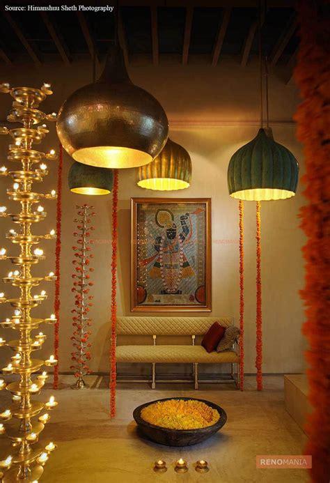 big hanging lights gods painting small lights  puja