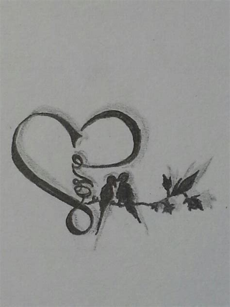 love birds tattoo shaped with in it with two birds on a