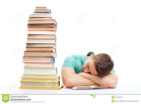 Student Sleeping On Desk by Sleeping Student Sitting At The Desk With High Books Stack