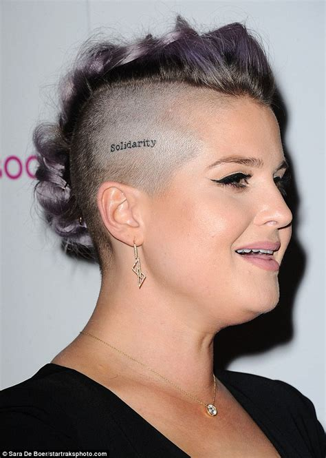 kelly osbourne displays solidarity head tattoo tribute