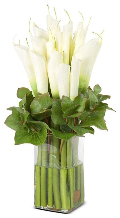 faux calla lily arrangement in glass vase white