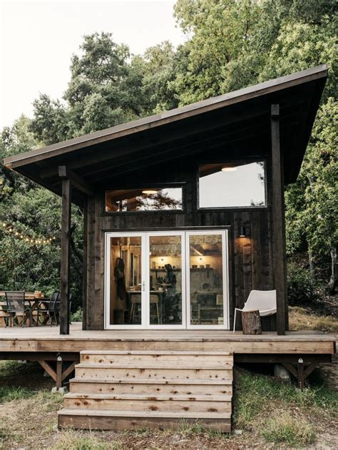 diy tiny home  slanted roof lots  windows  wide
