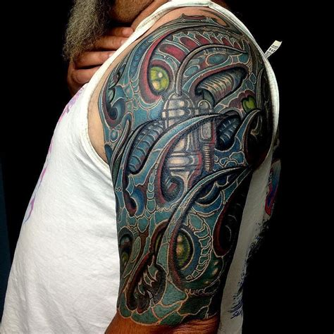 bio mechanical tattoo design 75 best biomechanical designs meanings top of