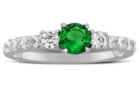 1 carat emerald and engagement ring in white gold