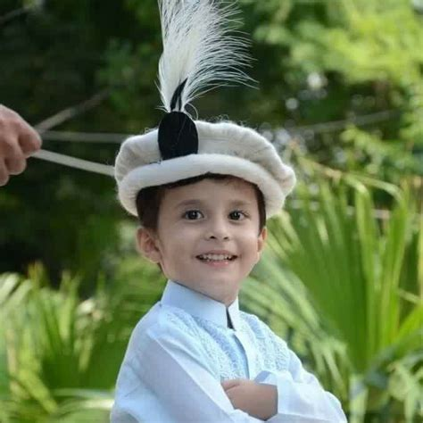 Topi Wool Bordir Fc Barcelona child wearing a traditional wool chitrali topi hat with