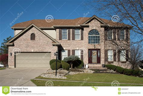houses with arched windows large brick home with arched window stock photo image