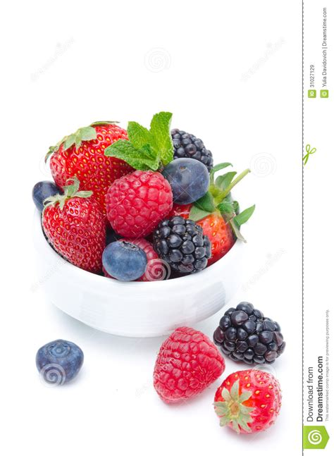 assorted of fresh berries in a white bowl isolated royalty