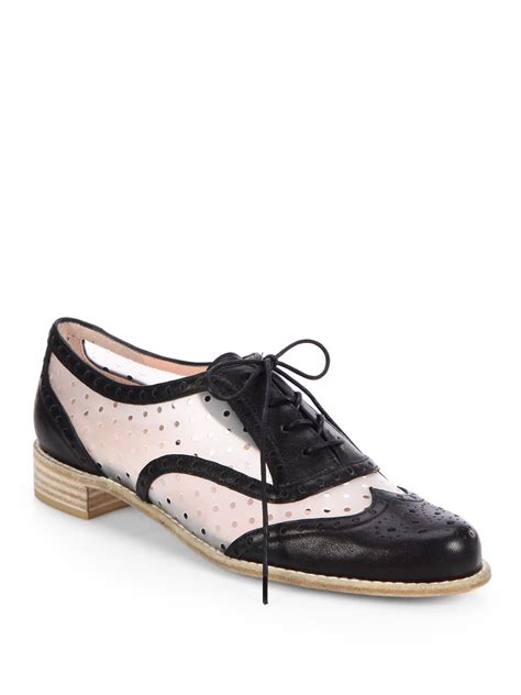 perforated oxford shoes stuart weitzman dandy perforated oxford shoes in black lyst