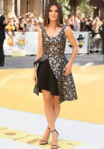 sandra bullock shows her style at minions premiere in paisley print dress uinterview