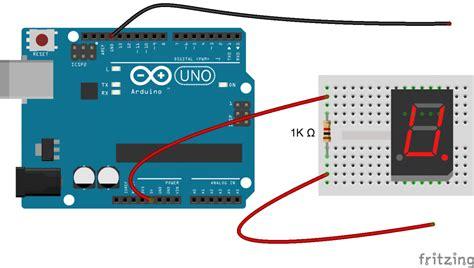 arduino tutorial 7 segment display how to set up 7 segment displays on the arduino circuit