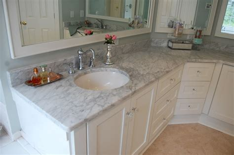 tile bathroom countertop bahtroom fresh flower decor beside round sink under tiny